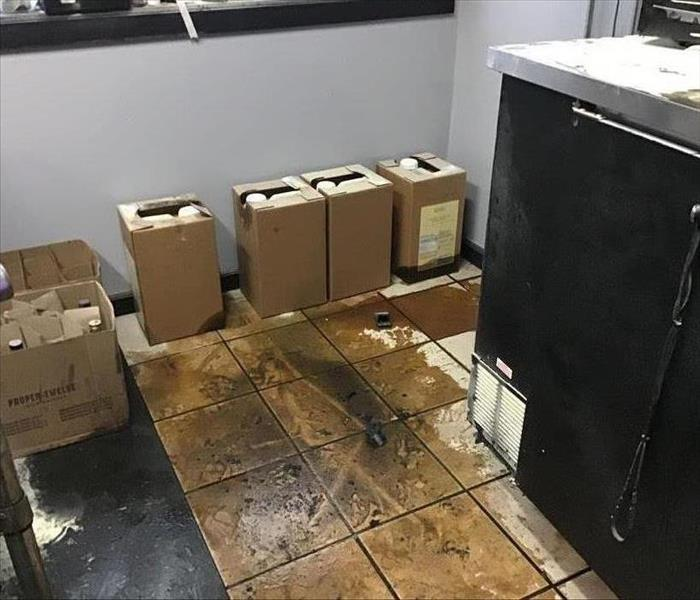 Floor of commercial kitchen after grease fire